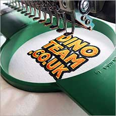 An embroidered logo being stitched